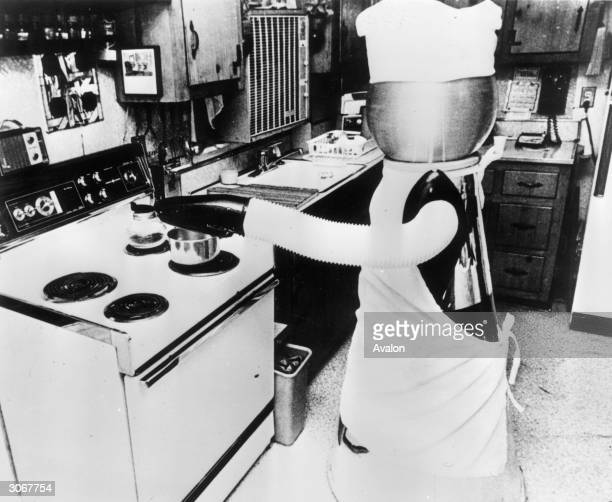A domestic robot developed by Quasar industries in America working in the kitchen