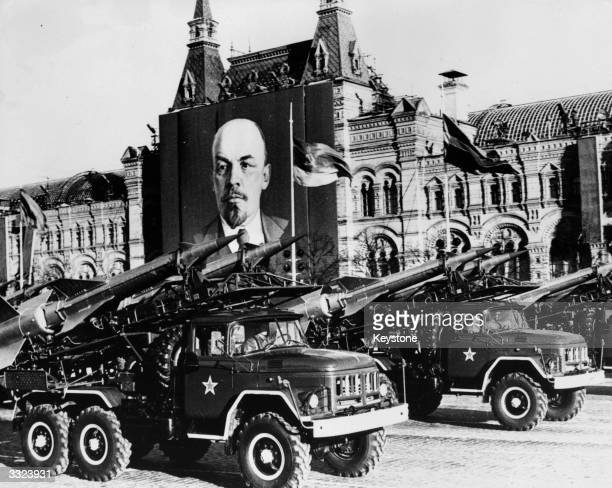 Missiles passing a poster of Lenin in Red Square Moscow during the 61st Anniversary of the Russian Revolution celebrations