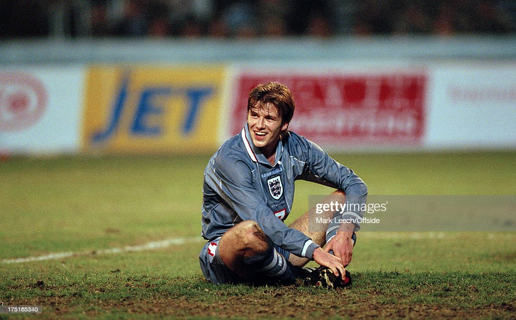 09 November 1996 - International football - Georgia v England - David Beckham sits in the goal area smiling after missing a chance.