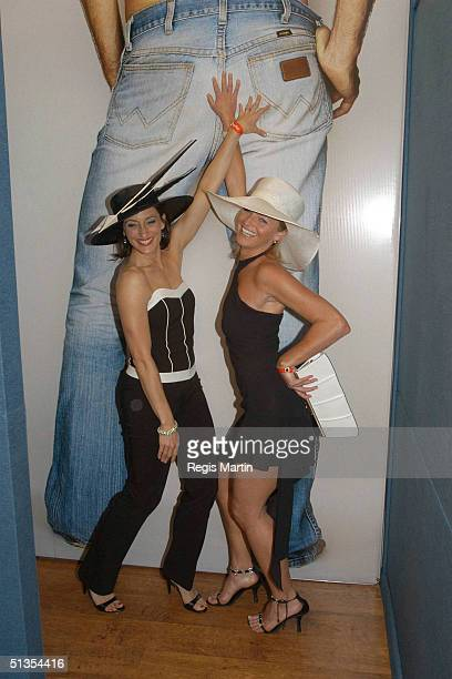 4 November 2003 Australian actresses GEORGIE PARKER and TAMMY MACINTOSH from All Saints at the Flemington Racecourse for the Melbourne Cup Day during...