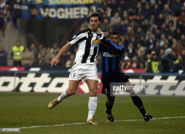 Zlatan Ibrahimovic of Juventus FC and Ivan Ramiro Cordoba of FC Internazionale compete for the ball during the italian Serie A 20042004 13 th round...