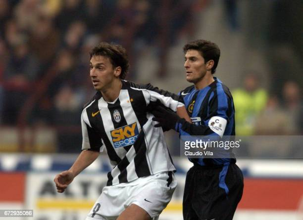 Zlatan Ibrahimovic of Juventus FC and Javier Zanetti of FC Internazionale compete for the ball during the italian Serie A 20042004 13 th round macht...