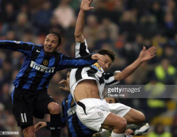 Zlatan Ibrahimovic of Juventus FC and Sinisa Mihailovic compete for the ball during the italian Serie A 20042004 13 th round macht played between...
