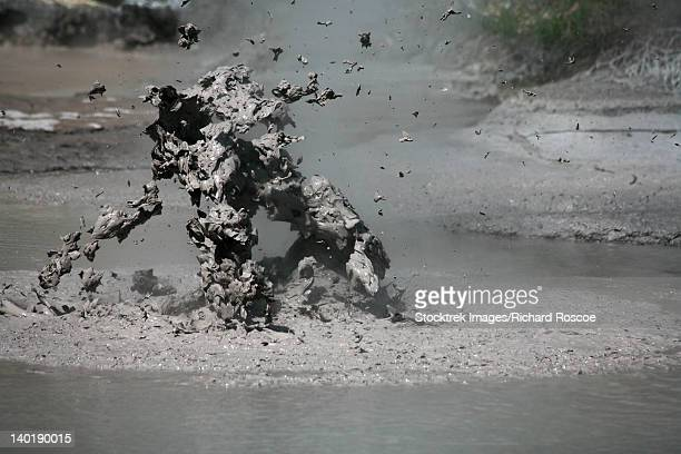 November 2007 - Bursting mud bubble, mud pools, Wai-O-Tapu Geothermal area, Taupo Volcanic Zone, New Zealand.