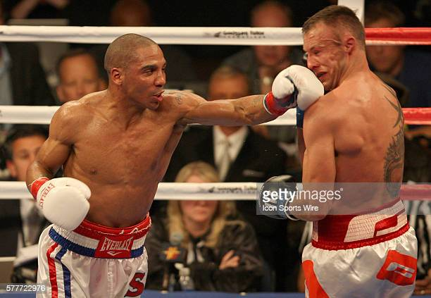Andre Ward throws a punch at Denmark's Mikkel Kessler during action at the Oracle Arena in Oakland California Ward the welterweight gold medalist at...