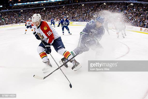 Third Period Aleksander Barkov of the Panthers spays Dan Hamhuis of the Canucks with snow during a game between the Vancouver Canucks and the Florida...