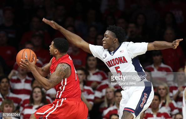 Arizona Wildcats forward Stanley Johnson tries to defend Cal State Northridge Matadors guard Aaron Parks during the second half of the college...