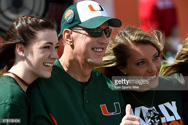 Jim Kelly smiles as he poses with his daughters Camryn and Erin on the sidelines before the start the NCAA football game between the North Carolina...
