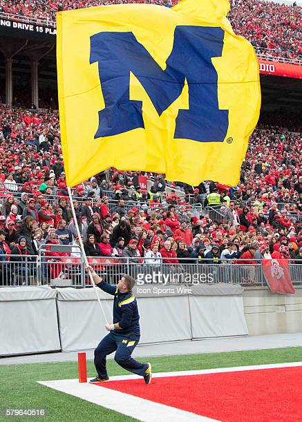 Michigan Wolverines flag waving in after a touchdown during the game between the Ohio State Buckeyes and the Michigan Wolverines at the Ohio Stadium...