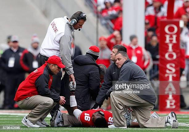Ohio State Buckeyes head coach Urban Meyer shows his support for Ohio State Buckeyes quarterback JT Barrett after a game ending injury during the...