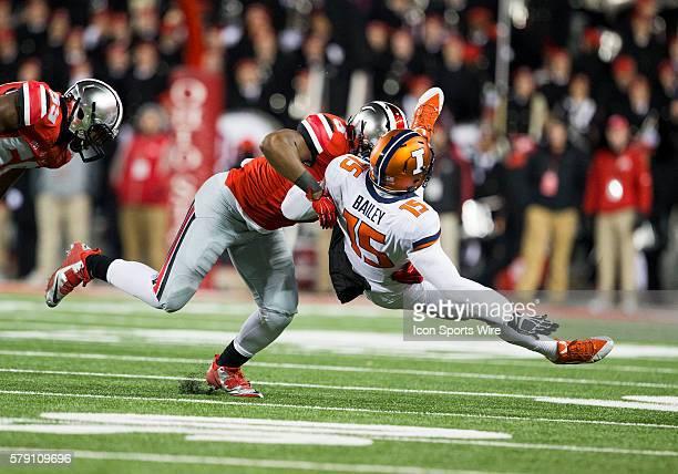 Ohio State Buckeyes linebacker Raekwon McMillan applies a big hit on Illinois Fighting Illini quarterback Aaron Bailey during the game between the...