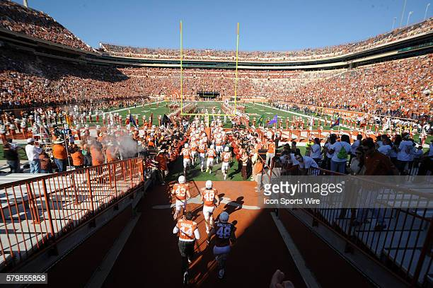 The Longhorns enter the field prior to 33 16 win over West Virginia at Darrell K RoyalTexas Memorial Stadium in Austin Texas