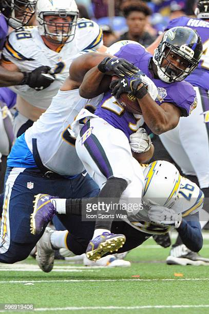 Baltimore Ravens running back Justin Forsett in action against San Diego Chargers cornerback Patrick Robinson at MT Bank Stadium in Baltimore MD...