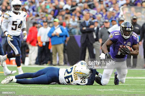 Baltimore Ravens wide receiver Kamar Aiken makes a reception and is brought down by San Diego Chargers cornerback Patrick Robinson at MT Bank Stadium...
