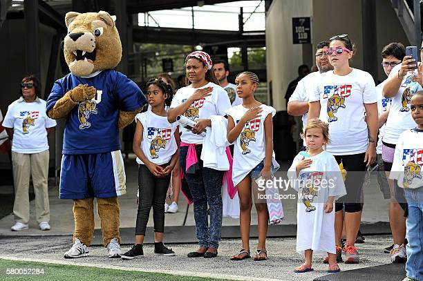 FIU's fans wearing tshirts given away for military appreciation day including a little girl whose tshirt fit more like a dress and FIU's mascot Roary...