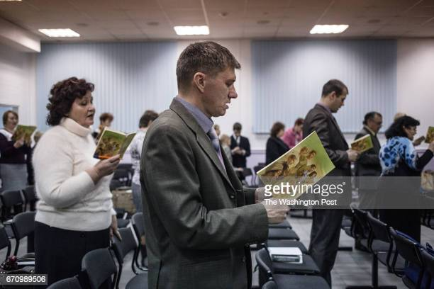 Jehovah's Witnesses sing songs at the beginning of the meeting in RostovonDon Although RostovonDon is only 80 km away from Taganrog the organization...