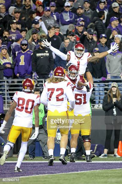 USC's Damien Mama lifts Jack Jones in the air after he scored a first quarter touchdown against Washington USC defeated Washington 3613 at Husky...