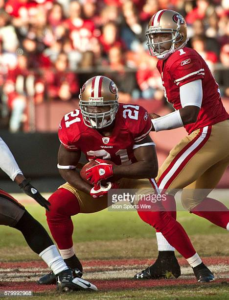San Francisco 49ers running back Frank Gore takes handoff from quarterback Troy Smith on Sunday November 21 2010 at Candlestick Park in San Francisco...