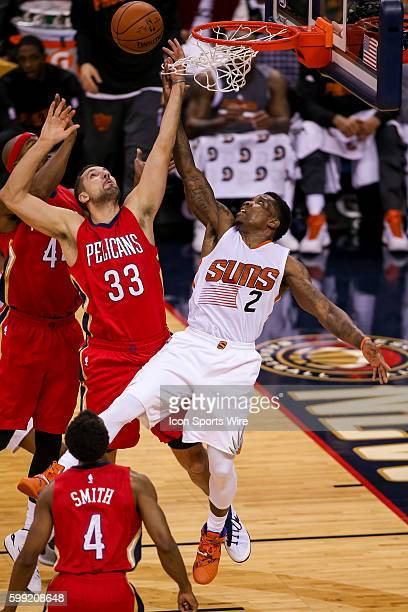 New Orleans Pelicans forward Ryan Anderson goes against Phoenix Suns guard Eric Bledsoe for a rebound during the game between the Phoenix Suns and...