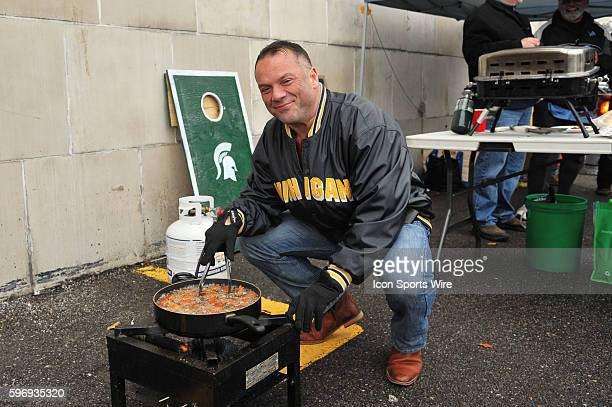 Mario Nasciamento of Montreal Canada and Mike Steffler of Windsor Canada deep fry chicken wings prior to the game on Thanksgiving Day Thursday...