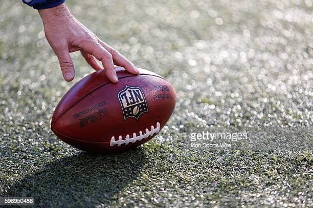 A sideline attendant picks up a ball landing out of bounds on an incomplete pass during the 1st half of the game between the Miami Dolphins and The...