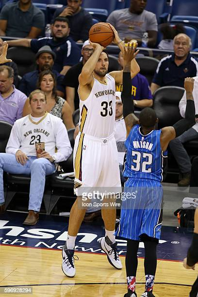 New Orleans Pelicans forward Ryan Anderson shoots the ball over Orlando Magic guard CJ Watson during the game between Orlando Magic and New Orleans...