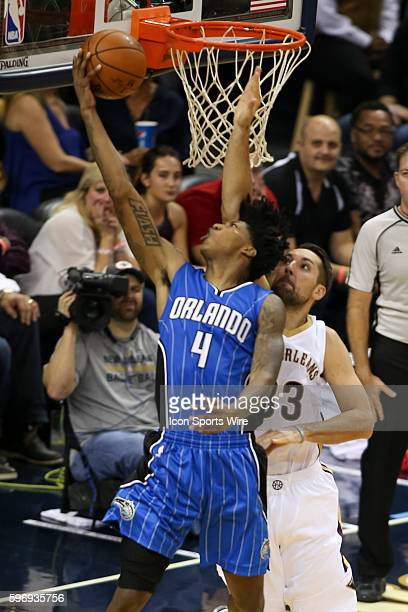 Orlando Magic guard Elfrid Payton shoots an underhand shot in front of New Orleans Pelicans forward Ryan Anderson during the game between Orlando...