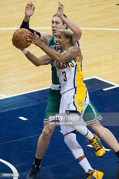 Indiana Pacers guard George Hill gets fouled by Boston Celtics center Kelly Olynyk during a NBA game between the Indiana Pacers and Boston Celtics at...