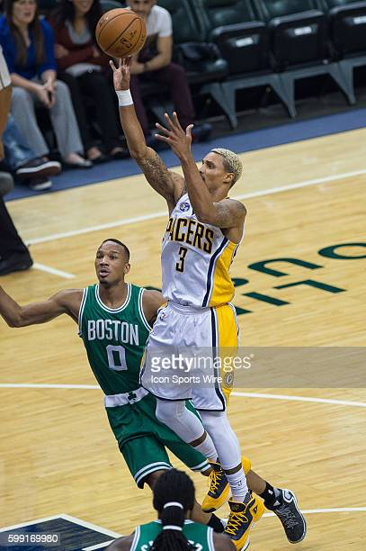 Indiana Pacers guard George Hill shoots in the lane over Boston Celtics guard Avery Bradley during a NBA game between the Indiana Pacers and Boston...