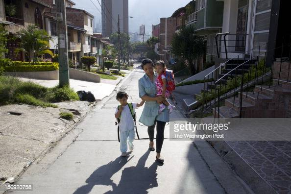 Galit Zapata takes her 4yearold son Baruj to kindergarten accompanied by her 2yearold daughter Gabriela