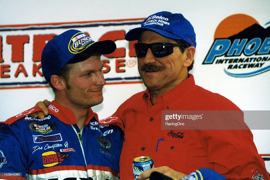 Although he finished second to <a gi-track='captionPersonalityLinkClicked' href=/galleries/search?phrase=Jeff+Gordon&family=editorial&specificpeople=171491 ng-click='$event.stopPropagation()'>Jeff Gordon</a> in the Outback Steakhouse 200 at Phoenix International Raceway, Dale Earnhardt, Jr. (L) and his dad Dale Earnhardt (R) had plenty of reason to celebrate, as the younger Earnhardt clinched the NASCAR Busch Grand National Series championship even though there was still one race to run the following week at Homestead-Miami Speedway.