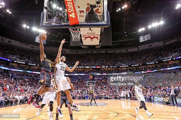 Atlanta Hawks guard Jeff Teague dunks the ball on New Orleans Pelicans forward Ryan Anderson during the game between Atlanta Hawks and New Orleans...