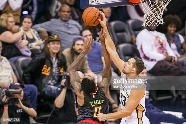 New Orleans Pelicans forward Ryan Anderson blocks the shot of Atlanta Hawks guard Jeff Teague during the game between Atlanta Hawks and New Orleans...