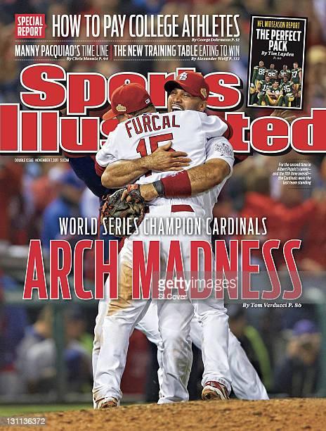 November 7 2011 Sports Illustrated Cover World Series St Louis Cardinals Albert Pujols victorious hugging teammate Rafael Furcal after winning Game 7...