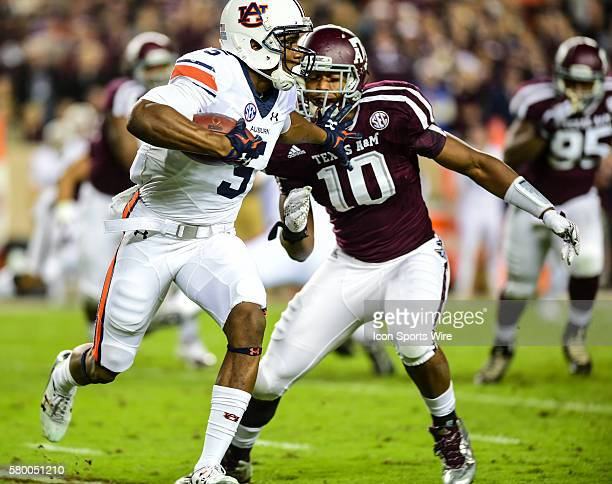Auburn Tigers wide receiver Ricardo Louis stiff arms Texas AM Aggies defensive lineman Daeshon Hall for a moderate first half gain during the Auburn...