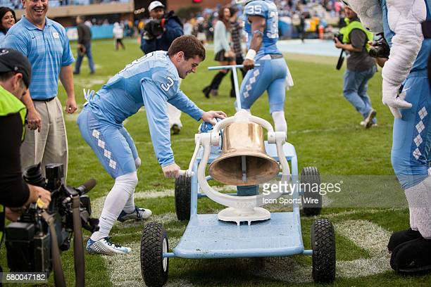 North Carolina Tar Heel wide receiver Ryan Switzer celebrates his Tar Heels' 6631 victory over rival Duke Blue Devils by ringing the victory bell at...