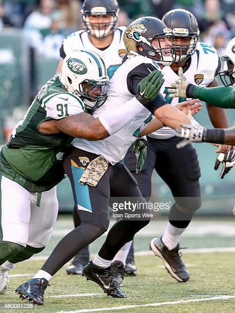 Jacksonville Jaguars Quarterback Blake Bortles [4448] is hit by New York Jets Defensive End Sheldon Richardson [18825] as he releases a pass during...