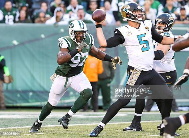 Jacksonville Jaguars Quarterback Blake Bortles [4448] just gets a pass off as New York Jets Linebacker Calvin Pace [4138] bears down on him from...