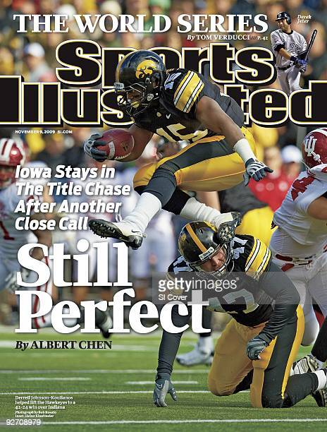 November 9 2009 Sports Illustrated Cover College Football Iowa Derrell JohnsonKoulianos in action jumping over teammate Wade Leppert during game vs...