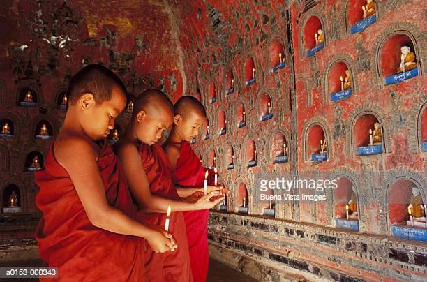 Novice Buddhist Monks Praying