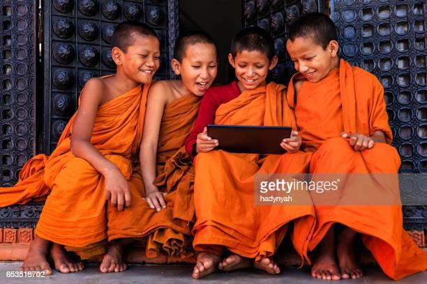 Novice Buddhist monks using digital tablet, Bhaktapur