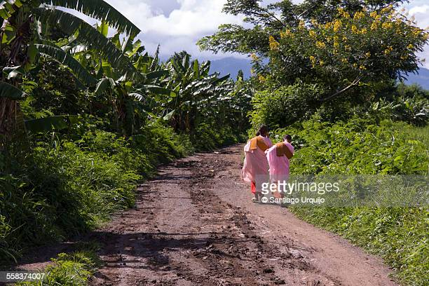 Novice buddhist nuns on a dirt road