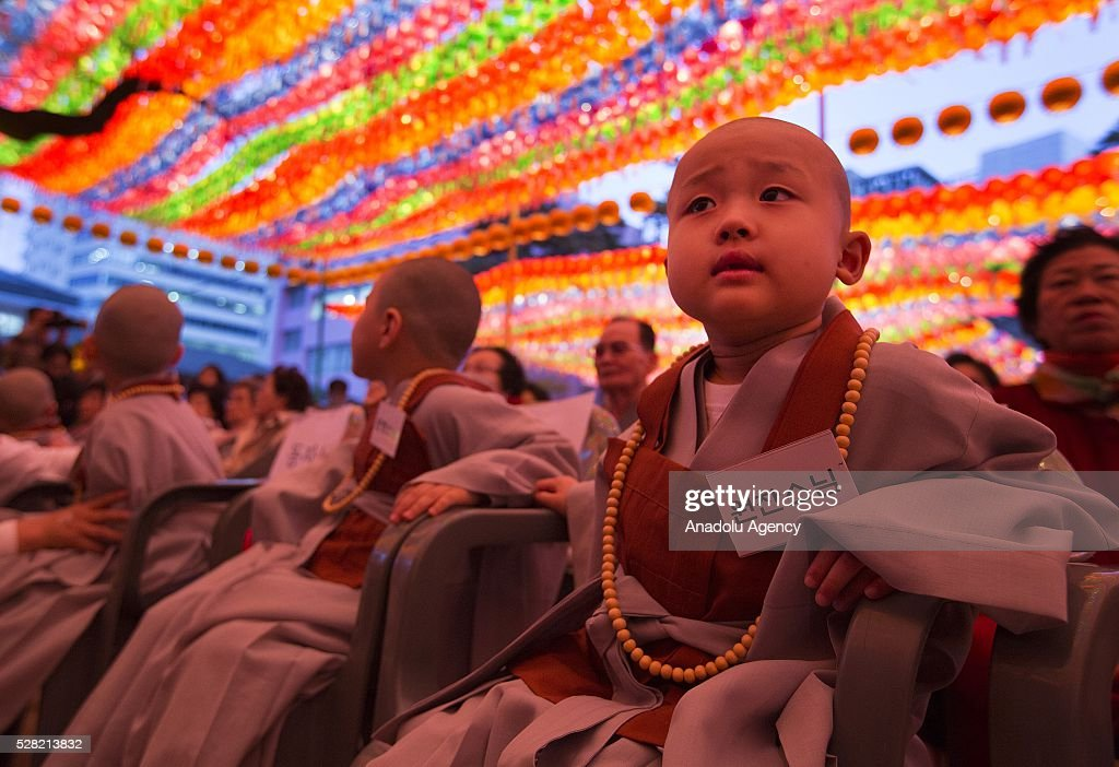 Novice monks and monks are seen under lanterns during a Lighting ceremony for the Lotus Lantern Festival to celebrate Buddha's birthday at the Jogye temple on May 4, 2016 in Seoul, South Korea.