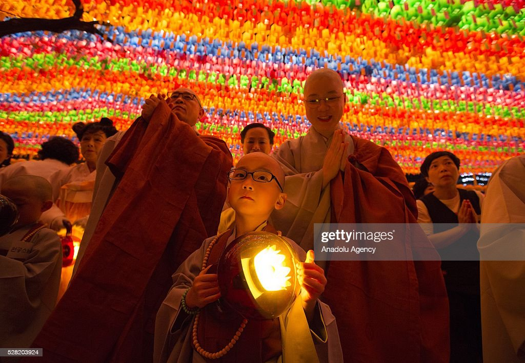 Novice monks and monks pray under lanterns during a Lighting ceremony for the Lotus Lantern Festival to celebrate Buddha's birthday at the Jogye temple on May 4, 2016 in Seoul, South Korea.