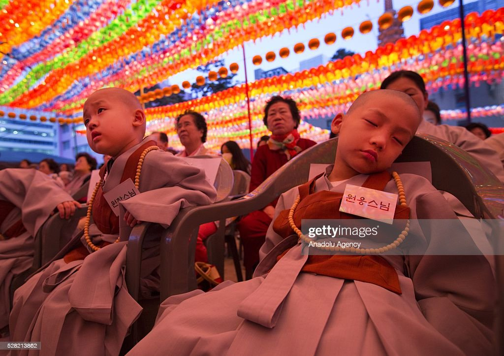 A novice monks sleeps under lanterns during a Lighting ceremony for the Lotus Lantern Festival to celebrate Buddha's birthday at the Jogye temple on May 4, 2016 in Seoul, South Korea.