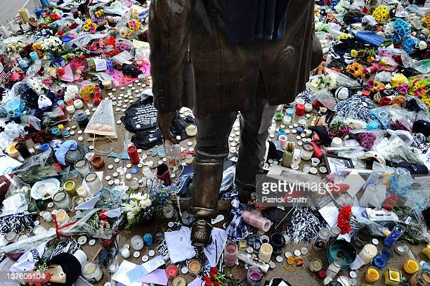 Now a makeshift memorial candles newspapers tshirts and other gifts line the ground of the statue of Joe Paterno the former Penn State football coach...