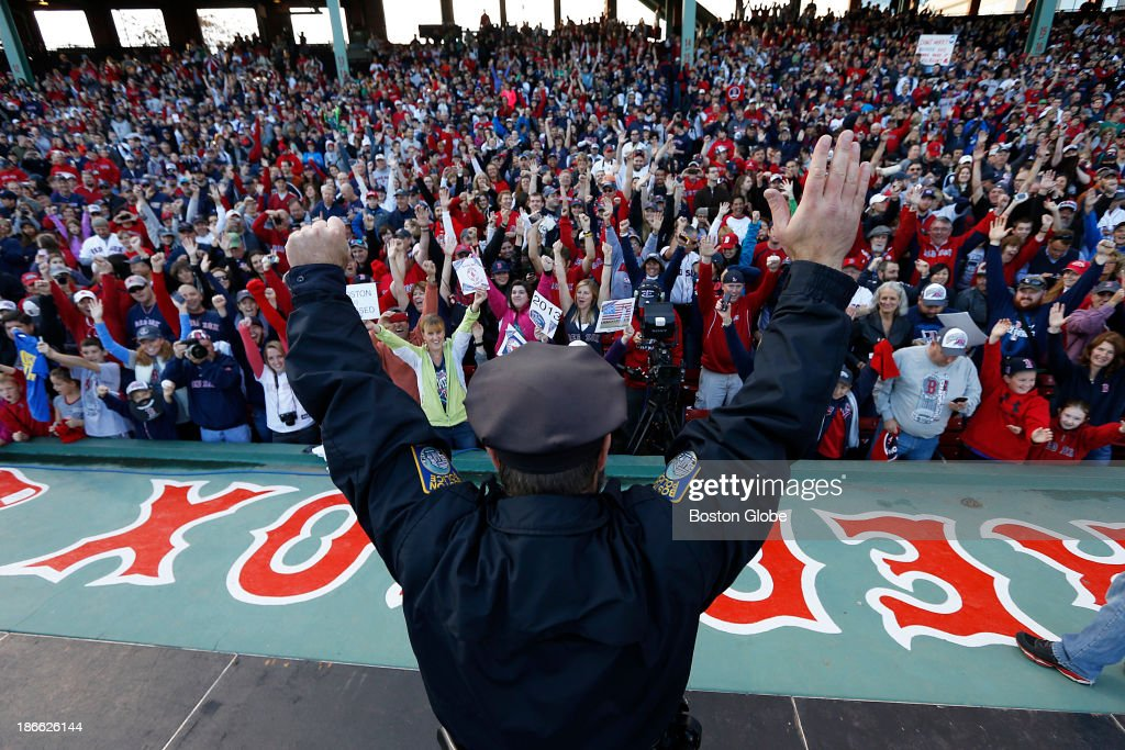 Now famous bullpen cop Steve Horgan put his hands up in the air to mimic his part in the iconic photograph from Game Two as the crowd cheered. The Red Sox Rolling Rally started at Fenway Park and paraded around Boston after the Boston Red Sox won the 2013 World Series, on Saturday, Nov. 2, 2013.