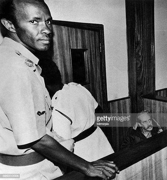 Now he sits drawn and haggard in the corner of the dock awaiting trial for his life in a Kampals courtroom Called the White Rat Astles was Uganda's...