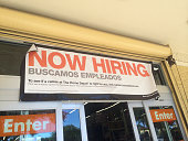 Now Hiring sign above the door of The Home Depot at Jacksonville Beach Florida USA on October 26 2014