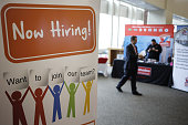 A 'Now Hiring' sign is displayed during a Job News USA career fair at Papa John's Cardinal Stadium in Louisville Kentucky US on Wednesday May 18 2016...